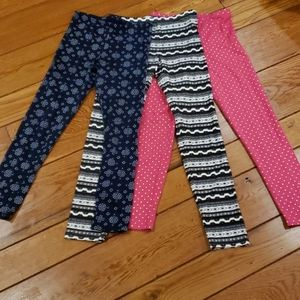 3 pairs of girls stretch pants . Size 10/12